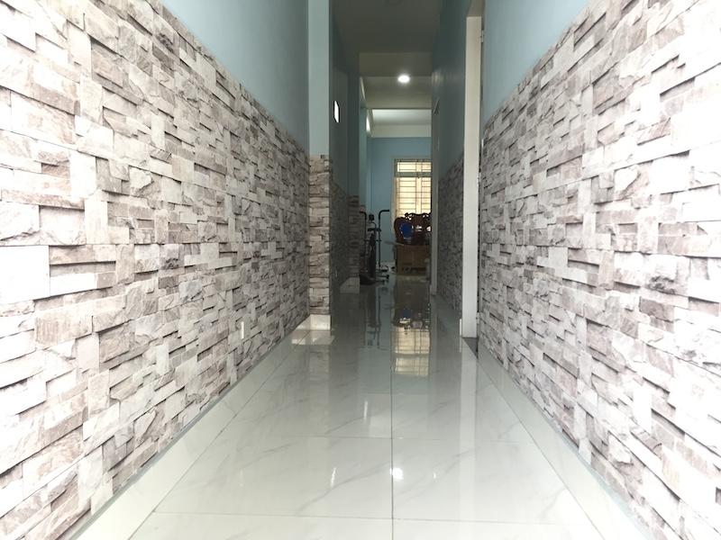 Giấy dán tường giả đá hành lang